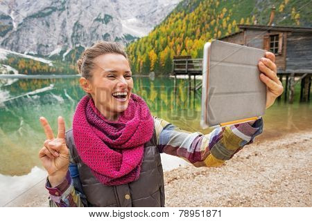 Happy Young Woman Making Selfie With Tablet Pc While On Lake Bra