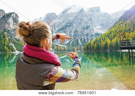 Young Woman On Lake Braies In South Tyrol, Italy Framing With Ha