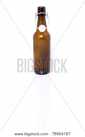 Old brown bottle of beer isolated on white.