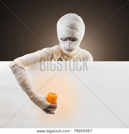 Halloween mummy with a candle