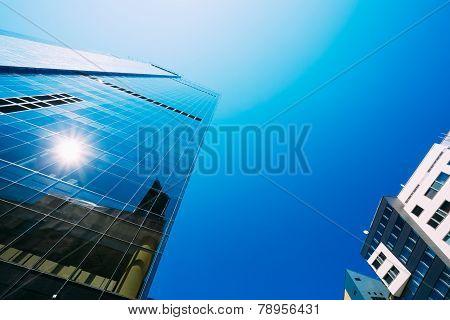 Blue Skyscrapers Background. Modern Architecture In Estonian Cap