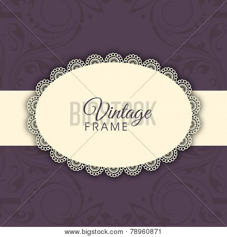 Oval shaped vintage frame with stripe behind on floral decorated purple background.