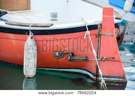 Cose Up Of A Red Hull With White Fender