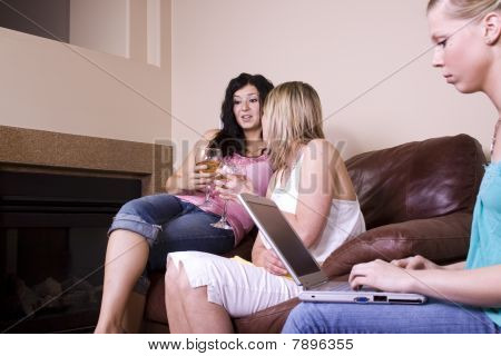 Three Women Socializing At Home