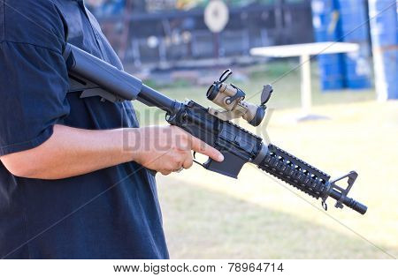 Air Gun In Asian Man's Hand.