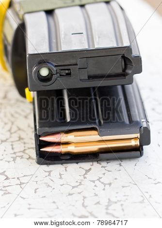 Closeup Of Tactical Military Bullets And Magazine For Gun.
