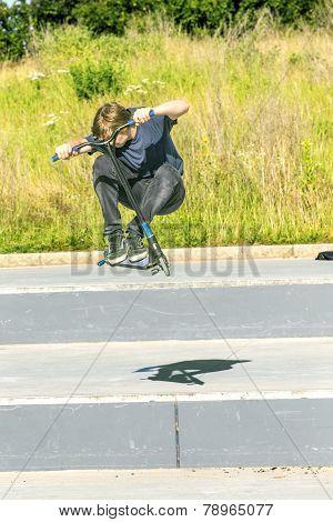 Boy Has Fun Riding His Push Scooter