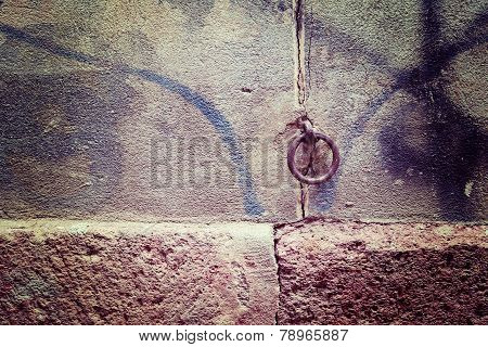 Metal Ring In  A Rustic Wall