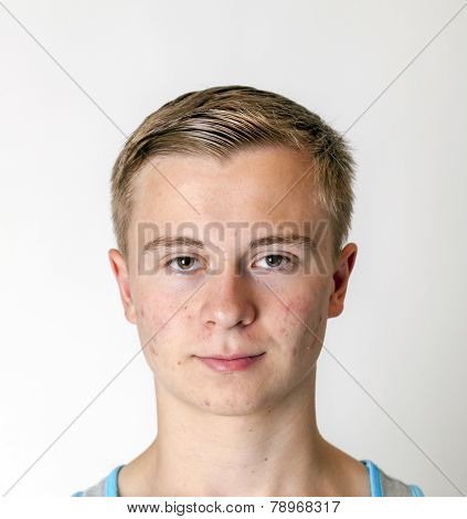Portrait Of A Positive Adolescent Boy In Puberty
