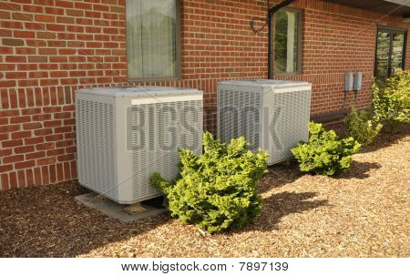 Two Central Air Conditioning Units