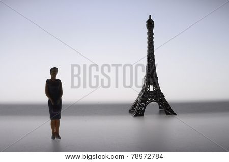 Parisian Woman In Front Of Eiffel Tower