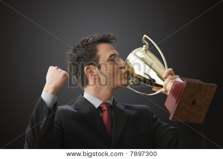 Businessman Kissing Trophy