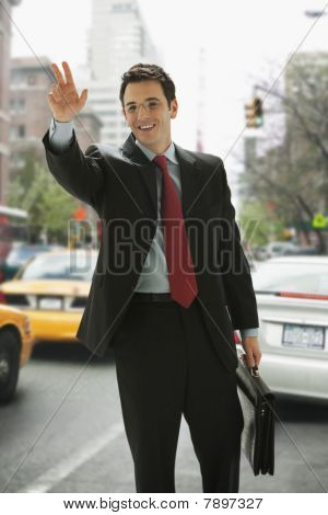 Businessman Hailing a Taxi