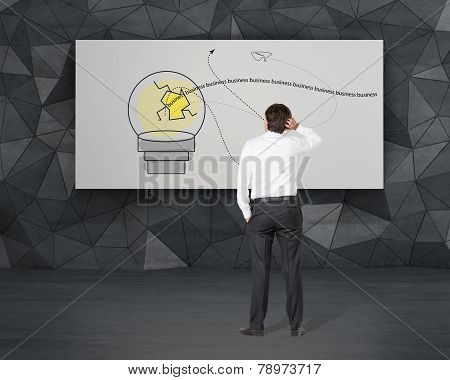 Businessman Looking To Lamp On Poster