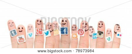 Finger With Popular Social Media Logos Printed On Paper.
