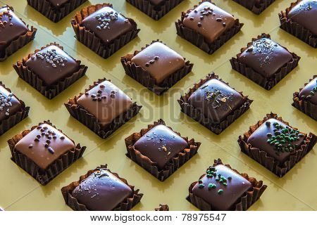 Handmade Chocolates Arranged In Grid
