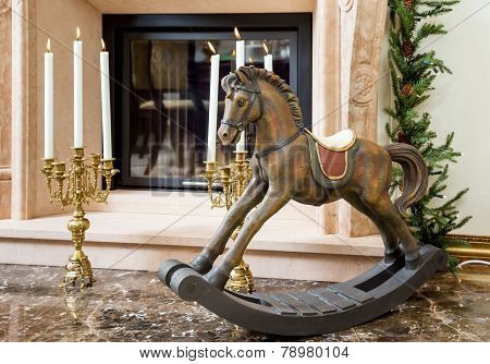 Old Wooden Rocking Horse Near The Fireplace