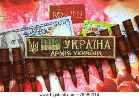 Kiev,Ukraine.Dec 20.Illustrative editorial. Chevron of Ukrainian Army.With logo Roshen Inc. Trademark Roshen is property of ukrainian president Poroshenko.At December 20,2014 in Kiev, Ukraine