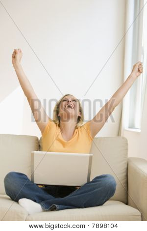 Cheering Woman with Laptop