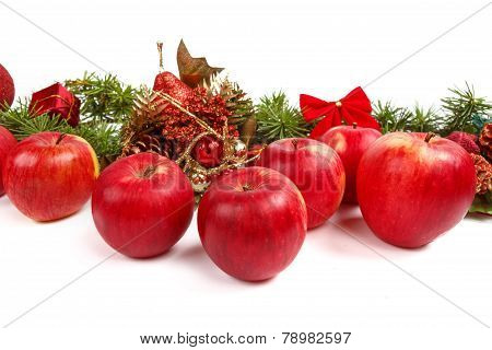 Christmas Decoration With Green Pine Or Fir And Many Scattered Red Apples
