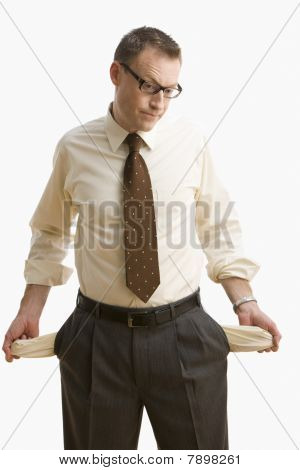 Businessman Emptying His Pockets - Isolated