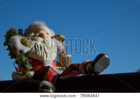 Santa Claus sitting  on blue sky background