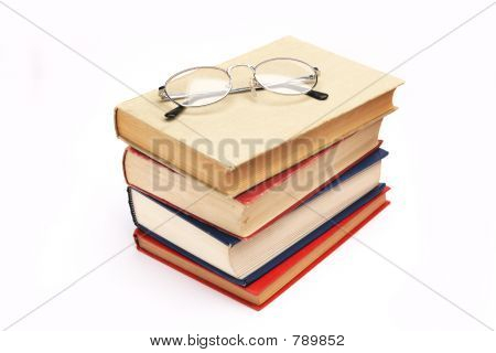 Pile of books with glasses