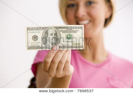Woman Holding 100 Dollar Bill