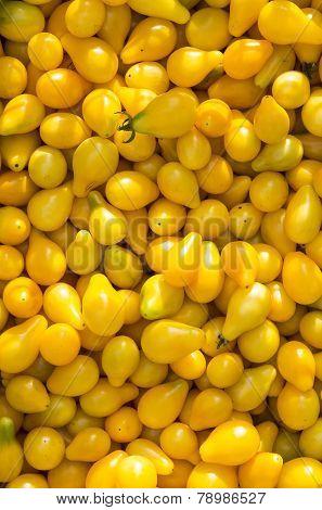 background of yellow ripe tomato closeup