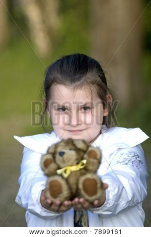 Girl Giving  Teddy Bear