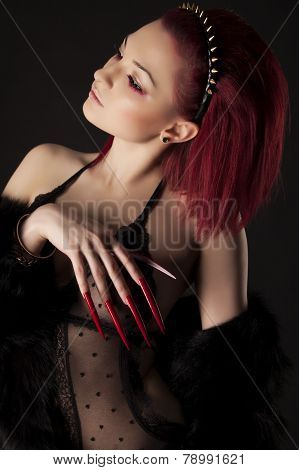 Beautiful Sexy Woman With Red Hair And Long Nails In Fur Coat