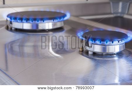 Closeup Shot Of Two Gas Burners In Line Located On Kitchen Stove
