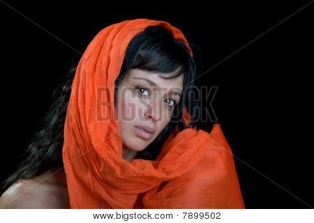 Beautiful woman wrapped in a scarf