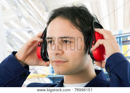 Worker wearing ear protectors