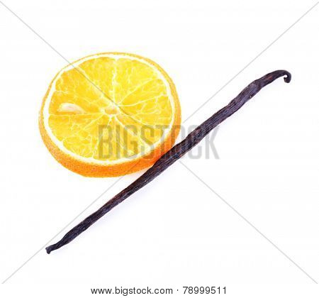 Dried orange with vanilla bean isolated on white
