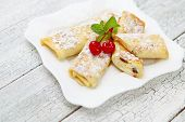 foto of crepes  - Tasty crepes on wooden table studio shot