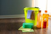 stock photo of detergent  - Wood cleaners and detergents on floor with bucket gloves cloth and sponges - JPG