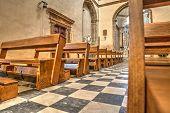 picture of pews  - Row of pews in Santa Maria church in Alghero Italy - JPG