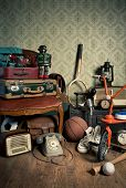 image of attic  - Assorted vintage items in the attic with retro wallpaper background - JPG