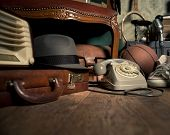 stock photo of attic  - Group of vintage objects on attic hardwood floor including old toys phone and sports items - JPG