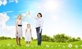image of dream home  - Happy family of three dreaming about home - JPG