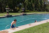 stock photo of playtime  - Boy girls playtime swimming pool home summer - JPG