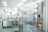 image of pharmaceutical company  - scientists at work in a research laboratory in pharmaceutical company