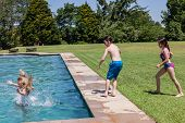 picture of playtime  - Boy girls playtime swimming pool home summer - JPG