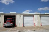 picture of firehouse  - firehouse garage with one truck coming out - JPG