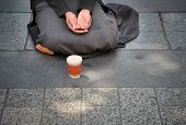 image of begging  - Woman with begging hands on the street