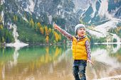 picture of south tyrol  - Child pointing on copy space while on lake braies in south tyrol italy - JPG