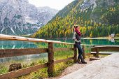 foto of south tyrol  - Full length portrait of young woman on lake braies in south tyrol italy - JPG