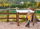 picture of south tyrol  - Portrait of baby near information board while on lake braies in south tyrol italy - JPG