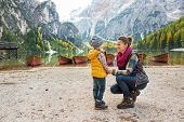 foto of south tyrol  - Mother and baby on lake braies in south tyrol italy